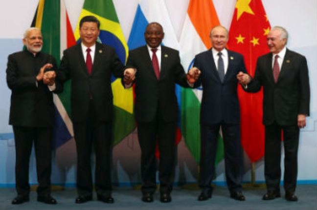 (From left) Prime Minister Narendra Modi, China's President Xi Jinping, South Africa's President Cyril Ramaphosa, Russia's President Vladimir Putin and Brazil's President Michel Temer. Reuters.
